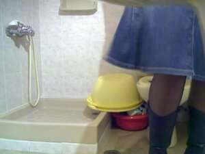Amateur blonde looks into the bowl pissing on toilet