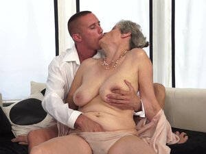Granny is sucking a horny hard young dick