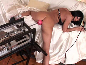 Short-haired minx uses an awesome sex machine to drill anal