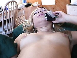 Saucy blonde chick squirts while talking on the phone