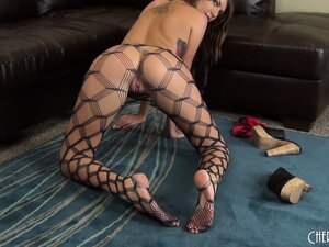 Cassandra Nix poses in her fishnet stockings and starts to finger her twat