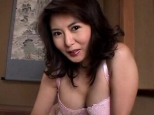Asian cutie with normal tits is wanking a dick