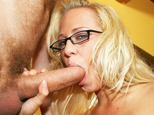 Blonde busty slut Carla Cox puts on her glasses before sucking some cock.