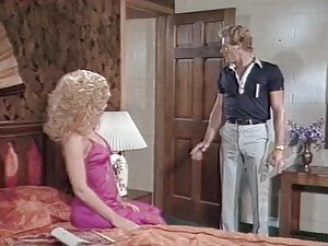 Nina Hartley and a guy practise 69 and fuck hotly on the sofa
