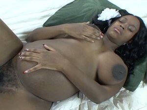 Pregnant ebony sluts milk their boobs and toy each other