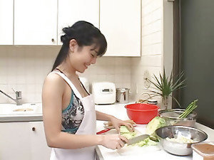 An adorable Asian housewife gets busy in the kitchen with her man's wang