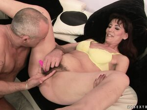 Gina gets her hairy bush fingered and then he adds a vibrator to it