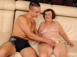 A granny has found a younger guy that's willing to fuck her old, gaping holes