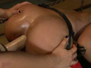 Ebony gets a strap on rammed down her rectum like crazy