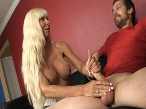 Gorgeous blonde is doing handjob