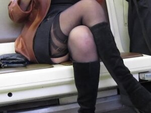 Girl check her dress and stockings in train