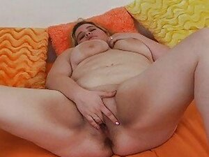Pale blonde milf with extra large tits fingers herself on the bed