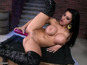 The busty Aletta sticks every inch of that dildo in her cunt and sighs with delight