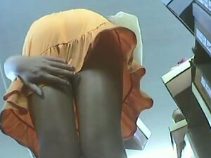long legged in a shoe shop upskirt bending over trying shoes