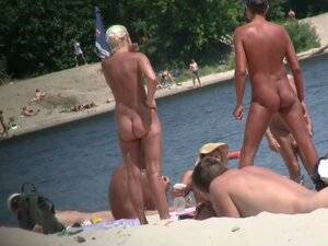 Sexy beach nudists got on voyeur cam with natural bodies