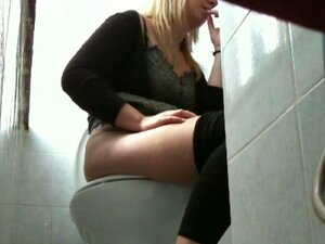 Toilet blonde girl pissing having no clue to be spied