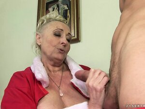 Horny grandma's Christmas sex fantasy turning into reality with a young man
