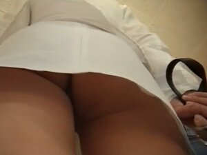 A fit brunette in a white skirt upskirt porno  white panties n' ass