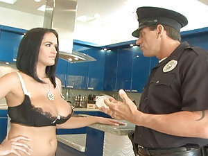 Carmella Bing gets it on with herself for a little while until she has a horny 911 - literally! The policeman arrives while she's masturbating, and she sorta gets dressed before answering the door. The officer pretends not to notice she's seducing him and