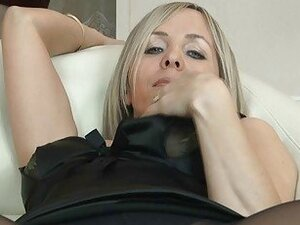 Sexy blonde milf in pantyhose uncovers her ass on sofa