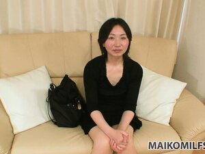 Naughty Asian milf in a sexy black dress shares her hot sexual fantasies and desires