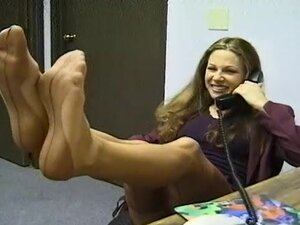 Business woman poses in her sexy stockings