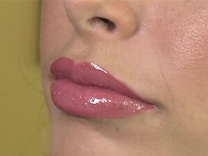 Pink gloss makes lips irresistible