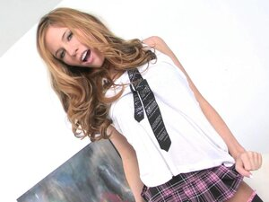 Pretty schoolgirl Bree Morgan takes off her short skirt