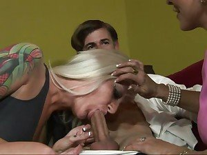 Horny mom shows her rampant daughter how to suck cock