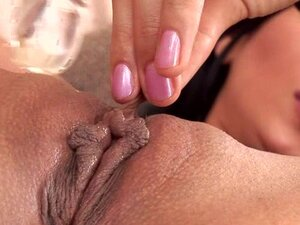 Lora poking her pussy with glass dildo