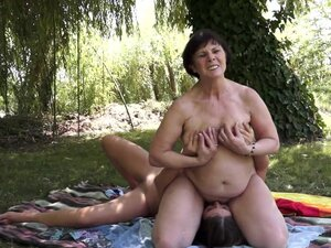 Mature brunette and her lesbian friend eat out each other