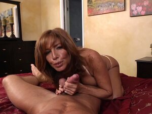 POV video of mature mommy Tara Holiday giving blowjob and footjob