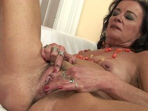 Sandora the horny grandma fingers and massages her wrinkly cooch